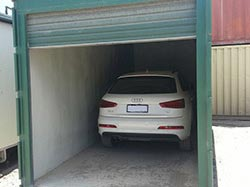 Cheap Garage / Portable Carport made from a shipping container
