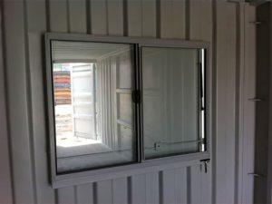 Transportable mobile workshop window inside