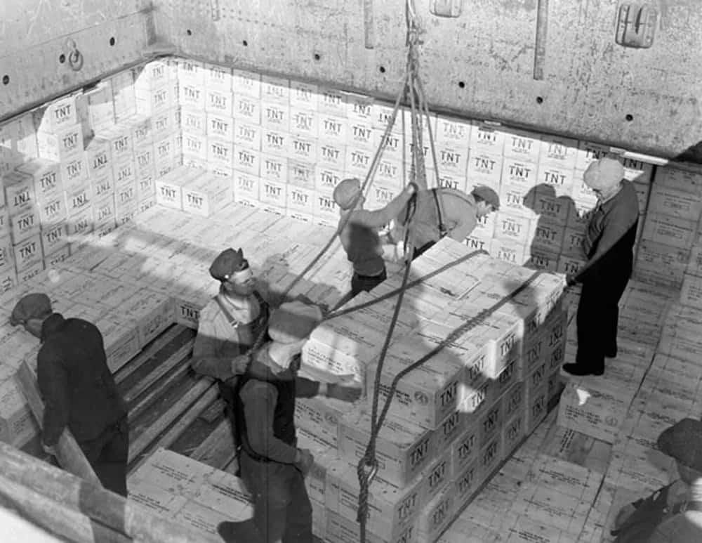 Longshoremen loading cases of TNT explosive